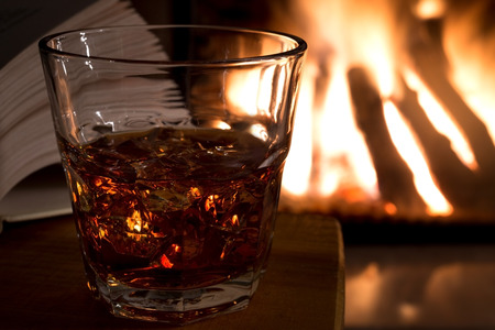 relax with a book and glass liquor lit fireplace