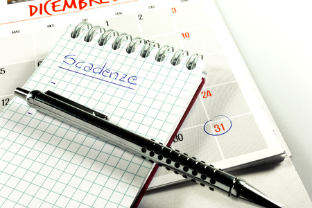 calendar and block notes for end-of-month maturities