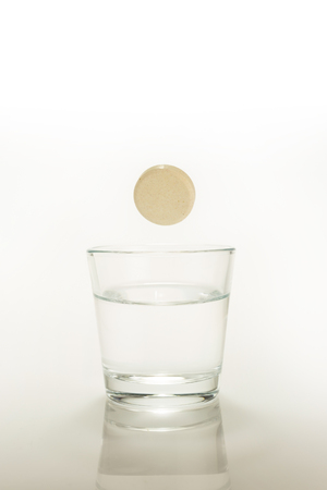 efervescent tablet dissolving in a glass of water