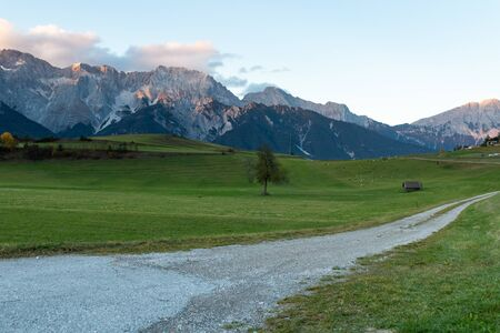 countryside and trails of an area of Austria with the mountains in the background Archivio Fotografico - 134717609