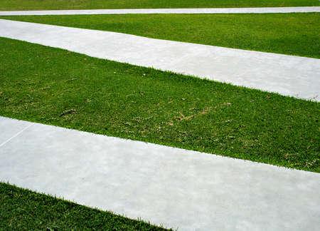 criss: Green grass, concrete paths criss cross