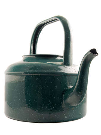 A green kettle against a white background photo