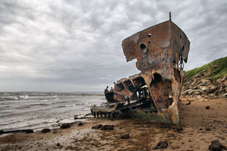 beached: A beached shipwreck on a stormy day