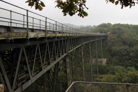 old railway bridge over a deep green gorge on a cloudy day, West England, Dartmoor National Park Reklamní fotografie
