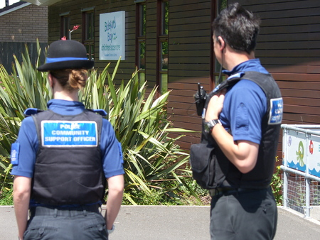 coppers: Devon and Cornwall police PCSO male, PCSO female on the beat in Bideford Park