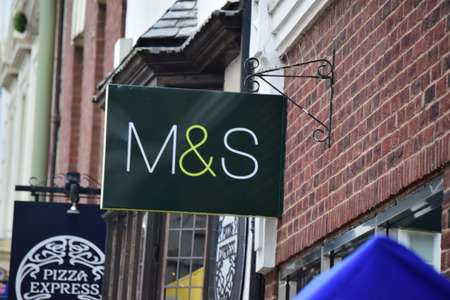 spencer: Marks & Spencer (M & S) logo advertising sign outside one of its retail supermarket stores in Barnstaple, England Editorial