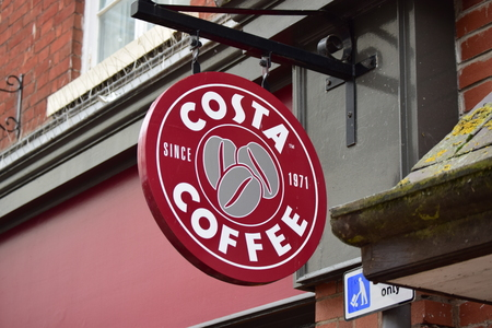 Barnstaple Costa coffee sign - osta Coffee has 1,700 stores in 28 countries. 1,375 cafes in the UK attract 4m customers a week.