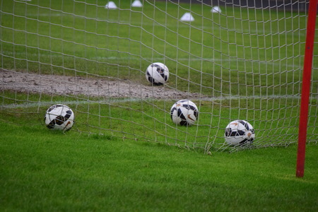 Footballs in the back of the net photo