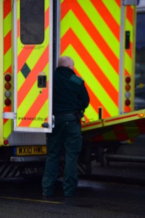 Paramedic getting equipment from the Ambulance