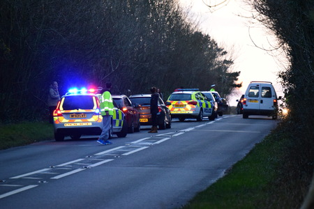 road shoulder: THE A39 is partially blocked after a two-car crash left oil and debris strewn across the road.  Police were called to the scene shortly after 3.30pm after receiving reports of a crash between a Peugeot 208 and Peugeot 106 near Fairy Cross.  PCSO Hannah De