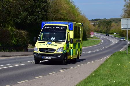 steam rally: Ambulance driving on the A39 Bideford, North Devon Editorial