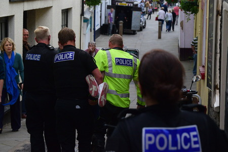 being arrested: This morning we arrested a local man who was wanted on a Recall to Prison.  The arrest at around 11:45 am involved a foot chase along Bideford Quay and then into Cooper street. Unfortunately just prior to the man being detained in Cooper Street a member o Editorial