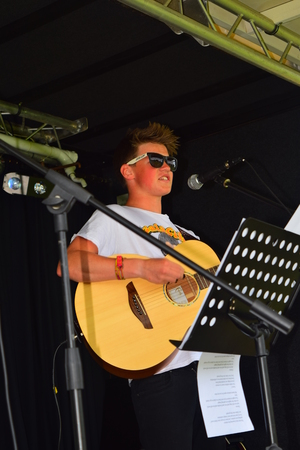 ethan: Ethan young on stage at Bideford Summer fete in Bideford park 2014 Editorial