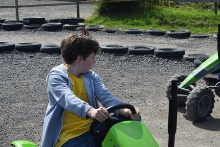 carting: Young boys playing on green go carts.