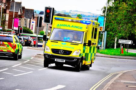 Ambulance on a 999 call with blue lights on