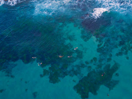Aerial view of group of surfers waiting for wave to come Stock Photo