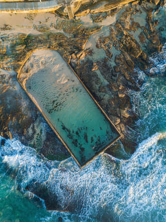 Aerial view of Cronulla ocean pool with incoming waves