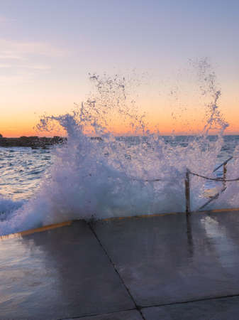 Ocean water splash from high tide and swell condition.