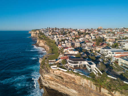 Aerial view of residential area across rock cliff area in Sydney coastline Stock Photo