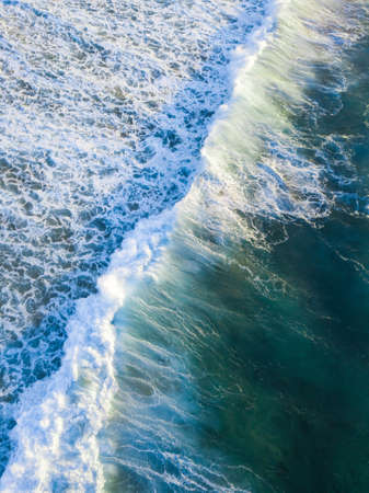breaking: Aerial view of incoming breaking waves.