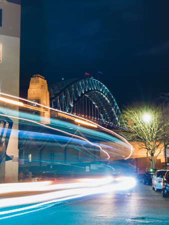 Trails of car light with Sydney Harbour Bridge on the background.
