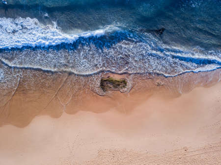 Aerial view of empty beach coastline.