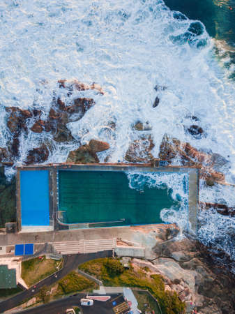 Top down aerial view of Dee Why rock pool with incoming wave. Sydney, Australia. Stock Photo