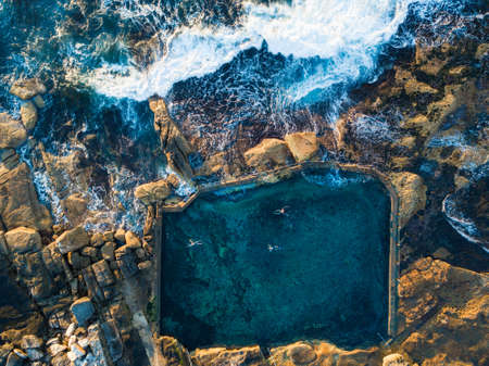 Top down view of Maroubra Mahon pool with people swimming. Sydney, Australia Stock Photo