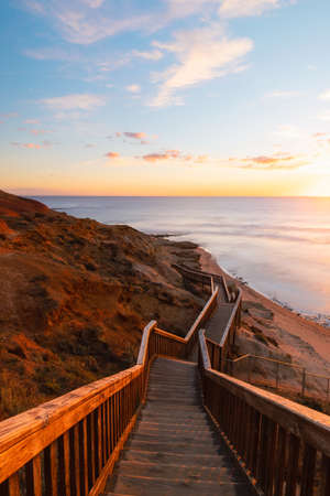 Stair walkway along the coastline with sunset view at Port Noarlunga, South Australia. Stock Photo