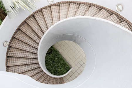 An empty outdoor spiral staircase with tile. Stock Photo