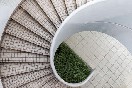 Empty spiral staircase in outdoor area.
