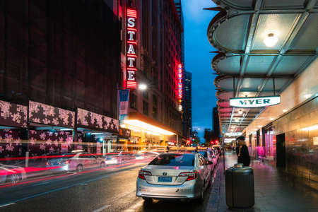 Sydney, Australia - March 14, 2020: Taxi and car trails in front of State Theatre in Sydney CBD Editorial