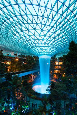 Singapore - February 6, 2020: Rain Vortex at Jewel light up with Cyan colour. Editorial