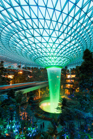 Singapore - February 6, 2020: Rain Vortex at Jewel light up with green colour.