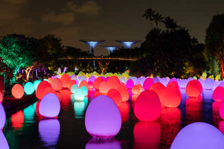 Singapore - February 7, 2020: Bright colorful lights at the lake of Gardens by the Bay.