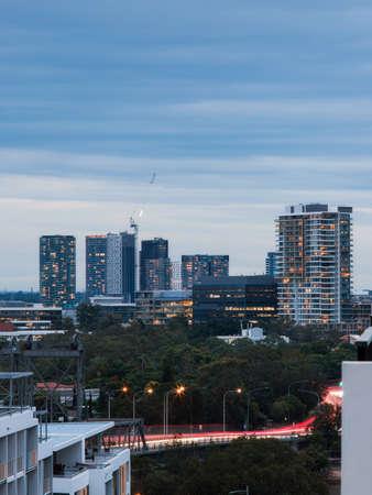 Sydney, Australia - April 8, 2020: Building skyline view around Rhodes area at dusk.