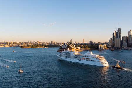 Sydney, Australia - March 20, 2020: Cruise ship at Sydney Harbour passing Sydney Opera House. Editorial