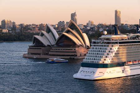 Sydney, Australia - March 20, 2020: A big cruise ship passing through Sydney Opera House. Editorial