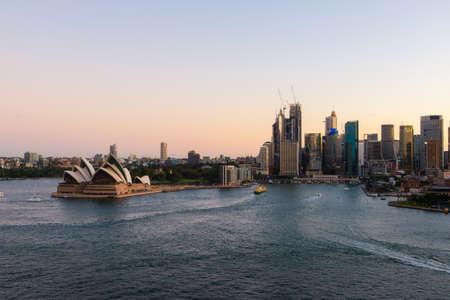 Sydney, Australia - March 20, 2020: Sydney Opera House and CBD skyline at sunset time.