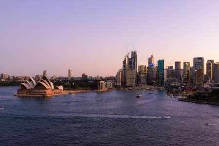 Sydney, Australia - March 20, 2020: Sydney Opera House and CBD skyline at dusk.
