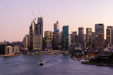 Sydney, Australia - March 20, 2020: Dusk view of Circular Quay and Sydney CBD skyline. Editorial