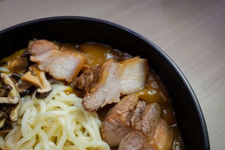 Close-up view of pork on a ramen bowl.
