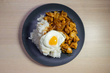 A plate of teriyaki chicken and fried egg with white rice. Stock Photo