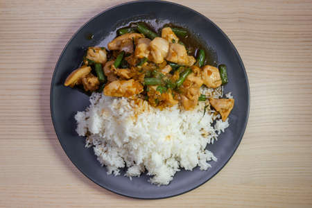 Stir fried chicken and green bean with white rice. Stock Photo