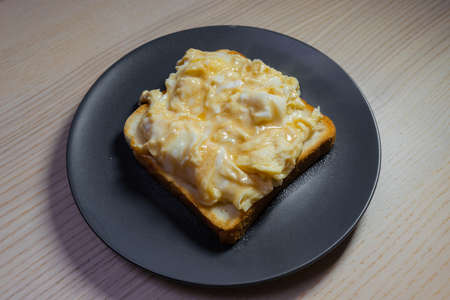 Scramble eggs on toast.