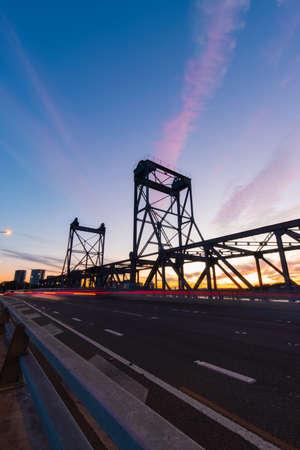 Car traffic at Ryde Bridge, Sydney, during sunset time. Stock Photo
