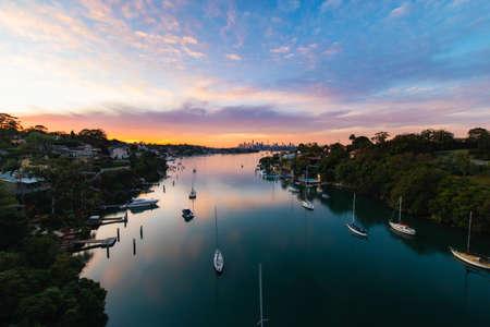 Sydney, Australia - May 20, 2020: Sydney skyline sunrise view over Parramatta River.