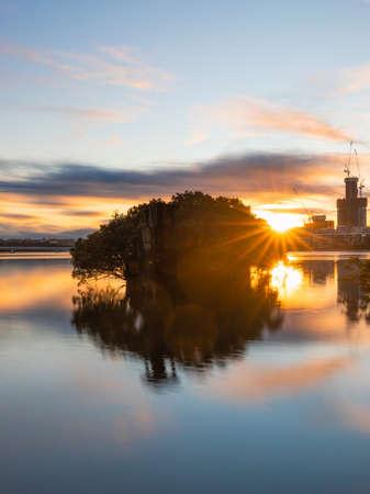 Sunrise view over SS Ayrfield shipwreck at Homebush Bay, Sydney, Australia.