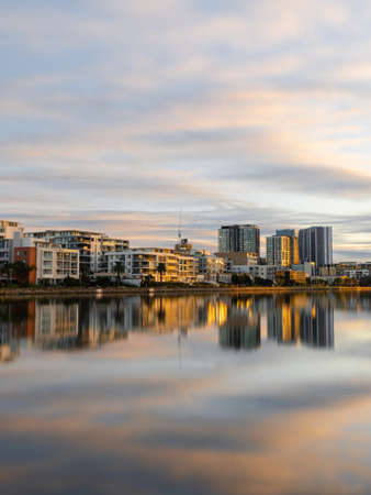Morning view of building skyline at Wentworth Point, Sydney, Australia with reflection on the water. Stock Photo