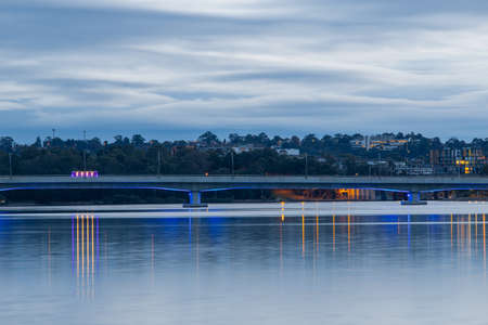 Bridge with blue light underneath at Homebush Bay, Sydney, Australia.